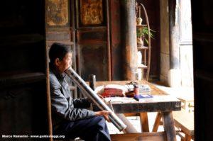 Homme, Tuanshan, Yunnan, Chine. Auteur et Copyright Marco Ramerini